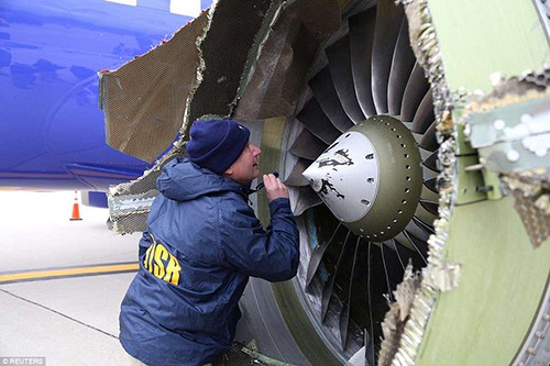A U.S. NTSB investigator is on scene examining damage to the engine of the Southwest Airlines plane in this image released from Philadelphia, Pennsylvania